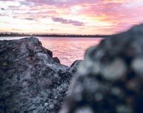 Pink Skies On The Rocks royalty free stock photos