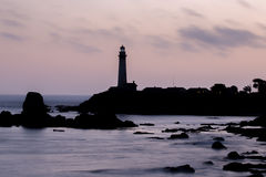 Pink Skies and Seascapes Silhouettes. Pigeon Point Lighthouse, Pescadero, California, USA Royalty Free Stock Image
