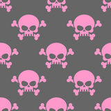 Pink skull on a grey background seamless pattern. Head of  skele. Ton and bones. Vector ornament for Halloween Royalty Free Stock Images