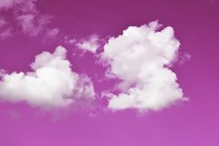 Pink sky background with white clouds stock images