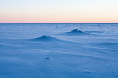 Pink sky reflected in the frozen sea to the horizon Royalty Free Stock Photos