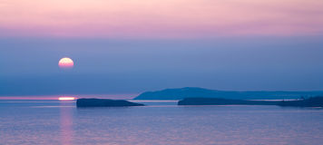 Pink sky, sunrise, sunset of the bay and islands Royalty Free Stock Image
