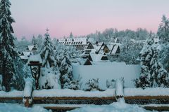 Winter morning in snowy mountain village stock image