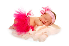 Pink Sleeping Newborn Baby Ballet Dreams. A Newborn Baby in Pink Tutu Dreams about Dance as she sleeps atop Pink Pointe Shoes Stock Images