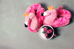 Pink Slippers with flamingo design. Fluffy pink trendy slippers with flamingo design royalty free stock photo