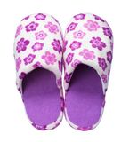 Pink slippers with flower print isolated on white background. Close up, high resolution Stock Photos