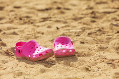 Pink slippers on sand. Stock Image