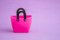 Pink Small Decorative Plastic Bags with handle on Purple  Backgr Royalty Free Stock Photos