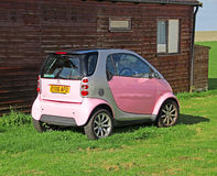 Pink smart car Royalty Free Stock Photo