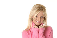Pink Smile. Pretty blonde woman smiling , while wearing a fuzzy pink sweater stock images