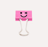 Pink smile binder clip isolated on white background stock photography