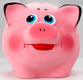 Pink smiles piggibank. Little pink happy piggi bank stock photos