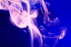 Pink Smoke On Blue. Abstract background with pink smoke on blue Stock Photography