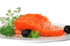 Pink smoked salmon on white plate with olives Royalty Free Stock Photography