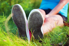 Pink sneakers on girl legs Stock Image