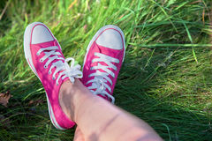 Pink Sneakers On Girl Legs Stock Images