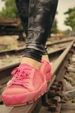 Pink sneakers on the railway Royalty Free Stock Photo