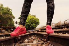 Pink sneakers on the railway Stock Images