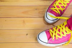 Pink sneakers. Top view on wooden background, with copy space for text Stock Images