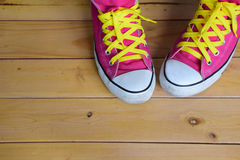 Pink sneakers. Top view on wooden background, with copy space for text Stock Image