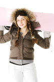Pink snowboard on woman shoulders Stock Images