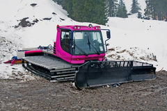 Pink snowcat in the dirt Stock Photos