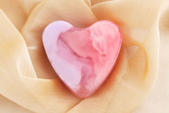 Pink soap. In the form of the heart  on the cloth Stock Photography