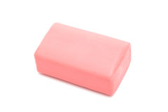 Pink soap. A piece of pink soap on a white background royalty free stock image