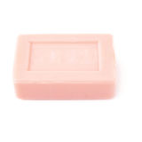 Pink soap bar isolated over white background Stock Image