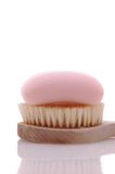 Pink Soap on Brush. Pink Bar of Soap on a Brush isolated over white stock photo