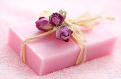 Pink soap with dried roses royalty free stock photo