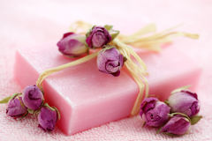 Pink soap with dried roses Stock Photos