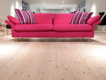 Pink Sofa. A relaxing pink sofa with pillows on a white pine wood floor Stock Images