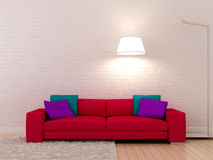 Pink sofa against a white wall Stock Photo