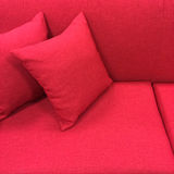 Pink sofa with cushions Stock Photos