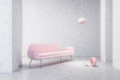 Pink sofa in empty concrete living room Royalty Free Stock Photography