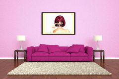Pink sofa with picture attached Royalty Free Stock Images