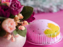 Pink soft cake. On pink background Stock Photos