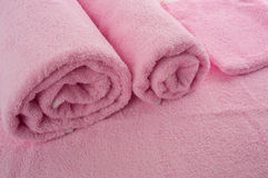 Pink soft towels. Rolled towels / texture of fabrics Royalty Free Stock Photography