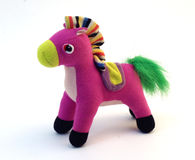 Pink soft toy horse. On a white background Stock Photo