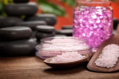 Pink Spa minerals and black stones Royalty Free Stock Photos