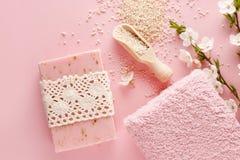 Pink spa set: bar of handmade soap, sea salt and towel. Royalty Free Stock Photo