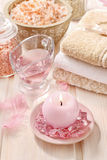 Pink spa set: liquid soap, scented candles, towels and rose sea Royalty Free Stock Photography