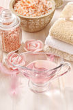 Pink spa set: liquid soap, scented candles, towels and rose sea Stock Photo