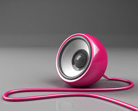 Pink speaker with cable over grey Royalty Free Stock Photo