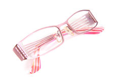 Pink spectacles on white background Royalty Free Stock Photos