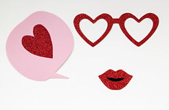 Pink speech bubble with red glitter heart, glasses and lips Stock Images
