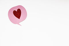 Pink speech bubble with red glitter heart Royalty Free Stock Photo