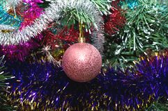 Pink sphere among a colour tinsel Royalty Free Stock Photo