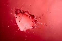 Pink Splashing Heart Stock Images